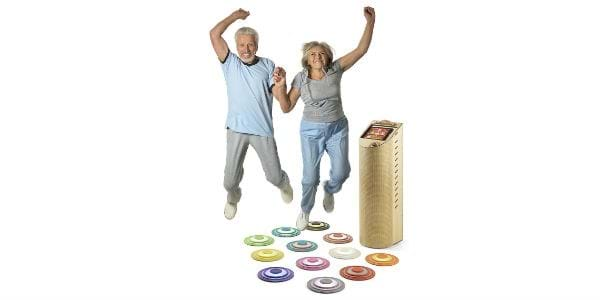 Two elderly jumping with Hopspots on the floor